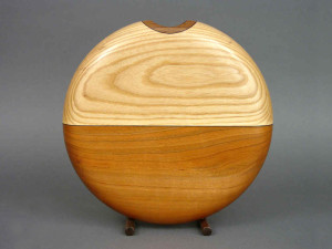 Circle vase of ash, cherry, and walnut.  Eleven inches diameter.